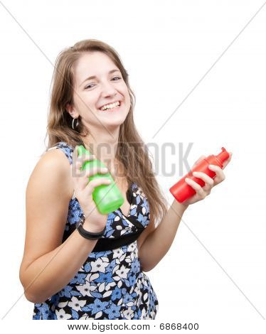 Long-haired Girl With  Toilletries Spray Over White