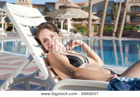 Girl Near Resort Swimming Pool