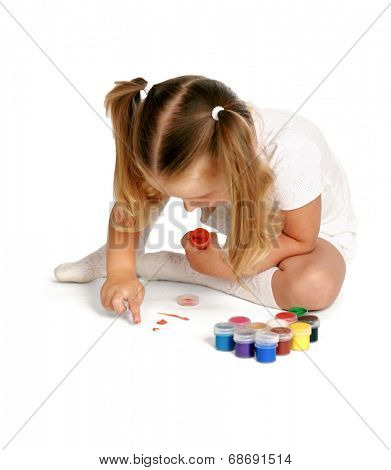 Child sitting on the floor and painting