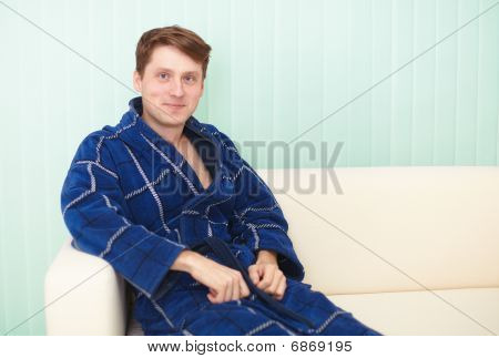 Guy Sitting On A Couch In Blue Gown