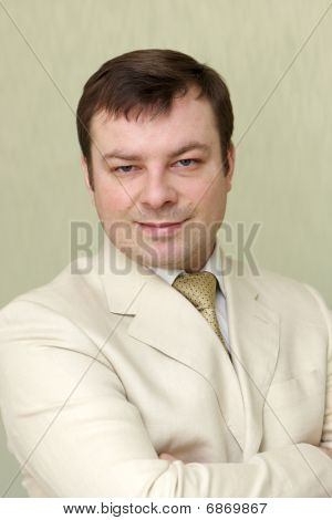 Man Poses On Green Background