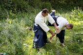 pic of aikido  - Training martial art Aikido. On nature. outdoors.
