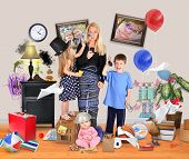 stock photo of discipline  - A working mother is stressed and tried on a cell phone with wild children and a baby making a mess in the home for a discipline or parenting concept - JPG