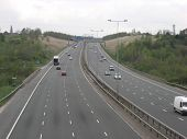 stock photo of m60  - A picture of the M60 Motorway taken from a footbridge near Daisy  Nook in Ashton - JPG
