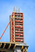 foto of formwork  - Concrete formwork with a folding mechanism on construction site - JPG