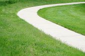 foto of curvy  - curvy cycling and running path on grass  - JPG
