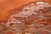 picture of derelict  - Orange brick wall with derelict decayed facade background - JPG