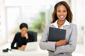 pic of clipboard  - black business woman holding clipboard with colleague on background - JPG