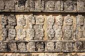 foto of mayan  - Mayan carving of skulls at Chichen Itza Mexico - JPG