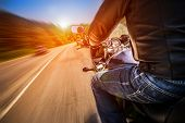 image of motorcycle  - Biker driving a motorcycle rides along the asphalt road - JPG