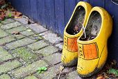stock photo of clog  - dirty Dutch clogs left outside to rot - JPG