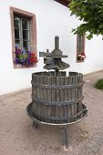 picture of wine-press  - Old disused wooden German barrel wine press - JPG
