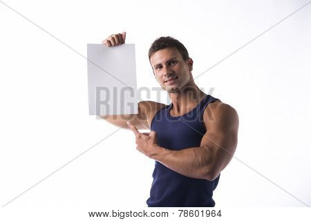 Handsome Muscular Man Pointing To A Blank Sign
