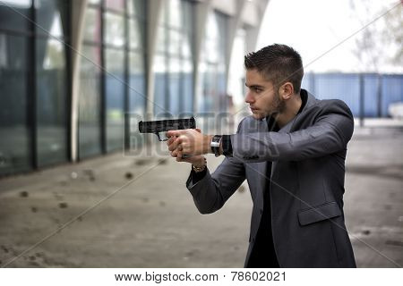Detective Or Mobster Or Policeman Aiming A Firearm