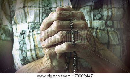 Senior Hands Holding Rosary Or Crucifix While Praying