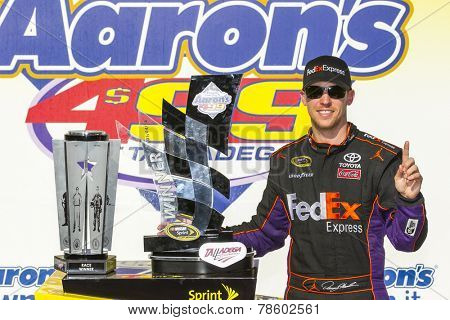 Talladega, AL - May 04, 2014:  Denny Hamlin (11) wins the