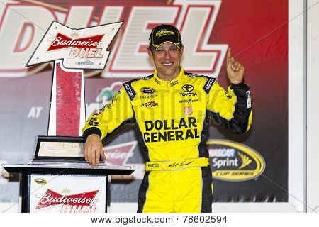Daytona Beach, FL - Feb 20, 2014:  Matt Kenseth (20) wins the Budweiser Duel at Daytona International Speedway in Daytona Beach, FL.