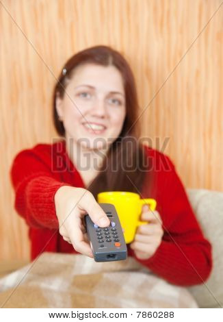 Woman Smiling With Tv Remote