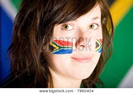 Young Female With Her Cheeks Painted With South Africa Flag