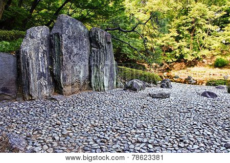 Zen stone path in a Japanese Garden Korakuen. Koishikawa Korakuen is one of oldest Japanese gardens in Tokyo. Japan, HDR