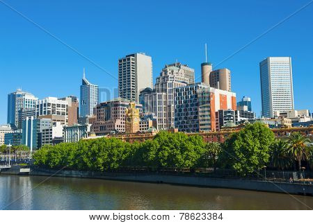 Melbourne skyline with skyscrapers and famous Flinders Streert train station seen across the river Yarra. Victoria, Australia