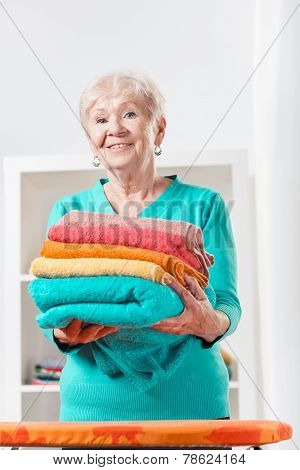 Woman Holding Towels