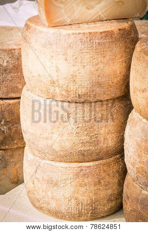 Stacked Rounded Cheese For Sale In Market