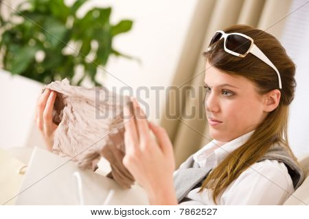 Young Businesswoman Unpacking Shopping Bag