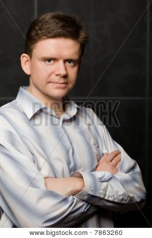 Young Man In Shirt Combined Hands Crosswise