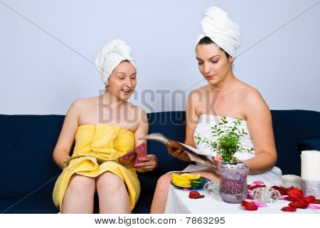 Women At Spa In Waiting Room Read Magazines