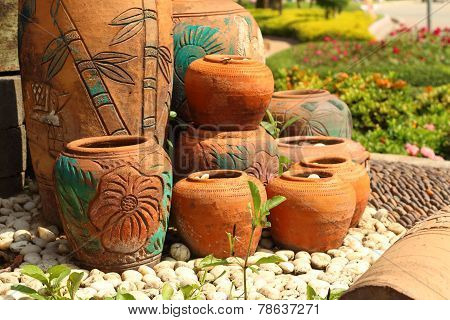 Earthen Jars Water And Coconut Shells