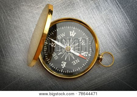 Compass On Steel Scratchy Background