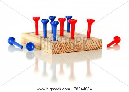 A nine-hole pegboard game with eight holes filled and three left over.  On a white background.