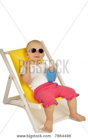 Funny Little Girl In Sunglasses On Little Yellow Deck Chair