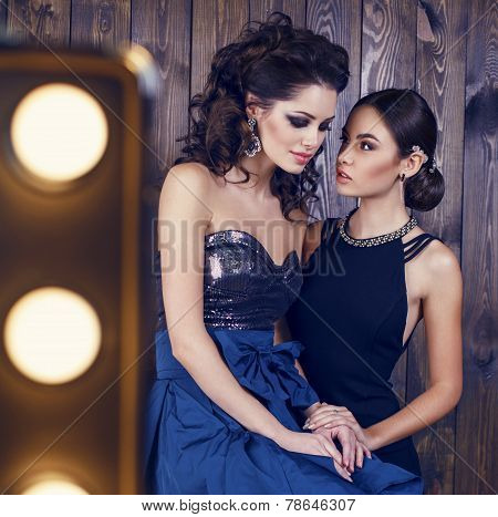 Two Beautiful Girls With Dark Hair In Luxurious Dresses
