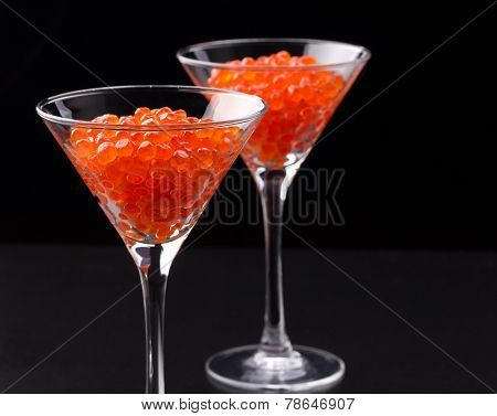 Red Caviar In Wineglasses On Black Background