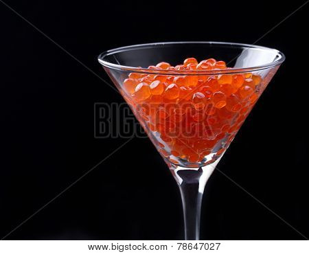 Red Caviar In Wineglass On Black Background