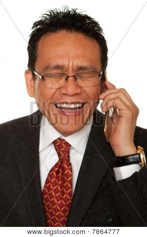 Businessman Laughs While Phone