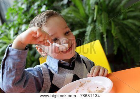 Kid Eating Cake