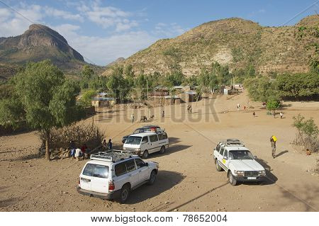 Tourist's cars parked at a small village, Adwa, Ethiopia.