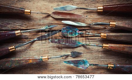 Artist Palette Knifes On Wooden Rustic Table, Retro Stylized