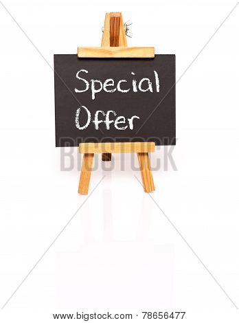 Special Offer. Blackboard with text and easel.