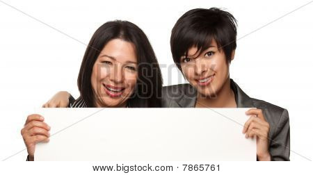Attractive Multiethnic Mother And Daughters Holding Blank White Sign