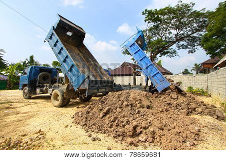 dumper truck on construction site,truck on a construction site in land.