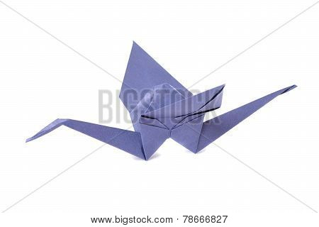 Violet origami crane isolated over white background