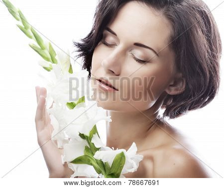 woman with gladiolus flowers
