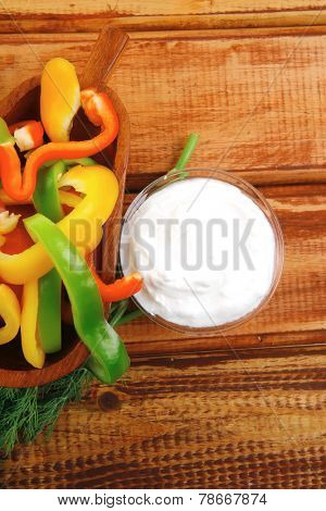peppers sliced for salad on wooden table