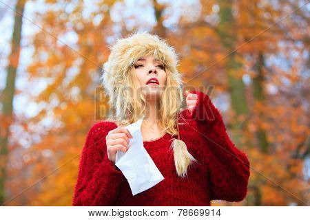 Sick Woman Sneezing In Tissue Outdoor