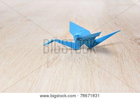 Origami Crane On Wooden Floor