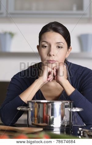 Unmotivated Woman Preparing The Dinner